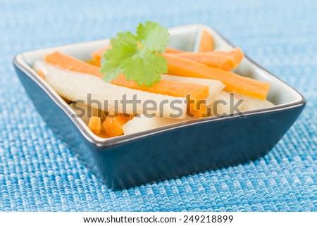 Do Chua - Vietnamese radish and carrot pickle. - stock photo
