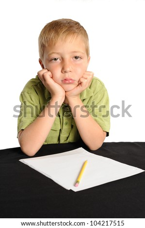 Do I Have to Work on my Homework? Seven year old boy refusing to start his homework. - stock photo