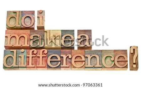 Do I make a difference? A question in vintage wooden letterpress printing blocks isolated on white. - stock photo