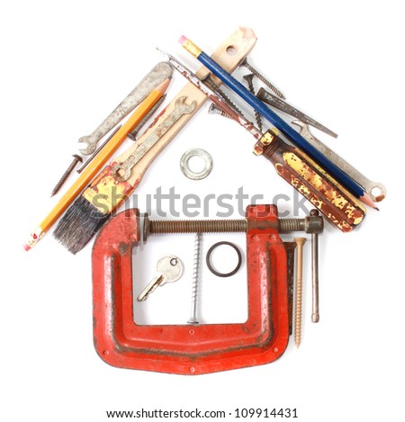 Do it yourself concept. House made from small tools - stock photo