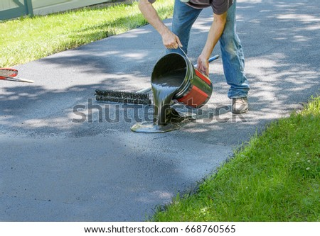 Driveway stock images royalty free images vectors shutterstock do it yourself home maintenance driveway resealing repair homeowner pours blacktop sealant onto driveway solutioingenieria Images