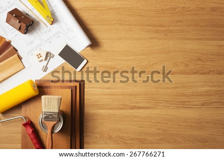 Do it yourself home remodeling and renovation concept, work table top view with copyspace and tools top view - stock photo