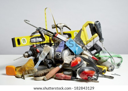 Do it yourself tools in pile on white background. Household DIY chore concept