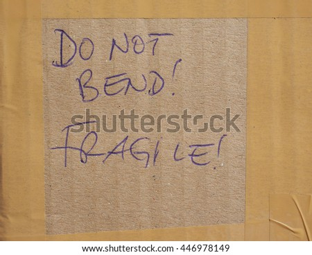 Do not bend! Fragile! handwritten on a corrugated cardboard - stock photo