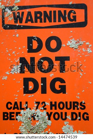 Do not dig warning sign with dirt - stock photo