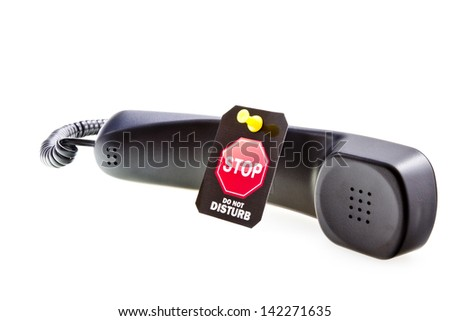 Do not disturb label with a thumbtack and phone tube. Do not disturb with your calls concept. Isolated on white. - stock photo