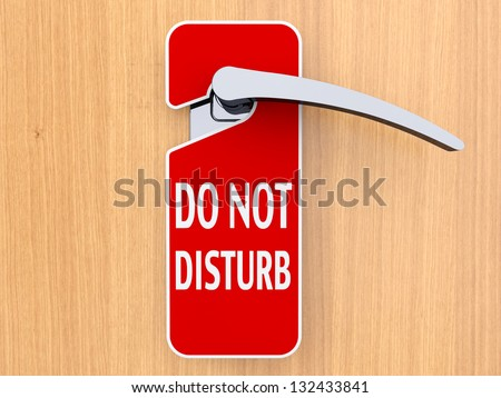 Do not disturb sign hanging on door in a hotel - stock photo