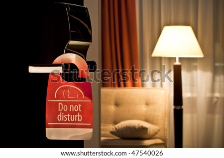 do not disturb sign hanging on open door in a hotel - stock photo
