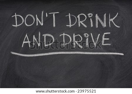 do not drink and drive warning handwritten with white chalk on a blackboard