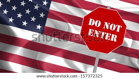 DO NOT ENTER message on stop board with USA flag in the background - stock photo