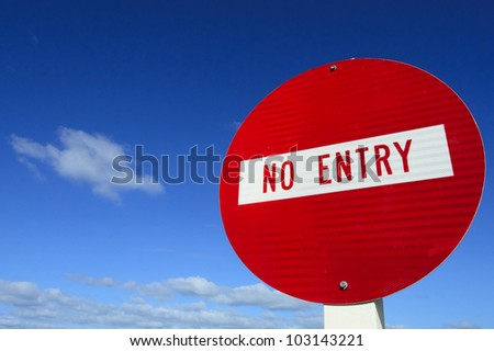 Do not enter - road sign under cloudy blue sky. - stock photo