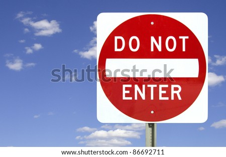 Do not enter sign on blue sky background with clipping path - stock photo