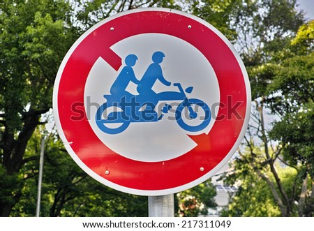 Do not enter to highway if two persons are riding on motorcycle, photographed in Tokyo, Japan - stock photo