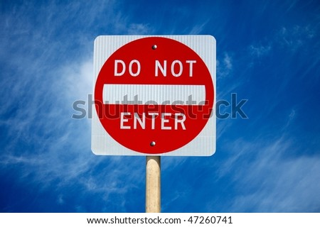 Do not enter traffic sign cloudy sky on background - stock photo