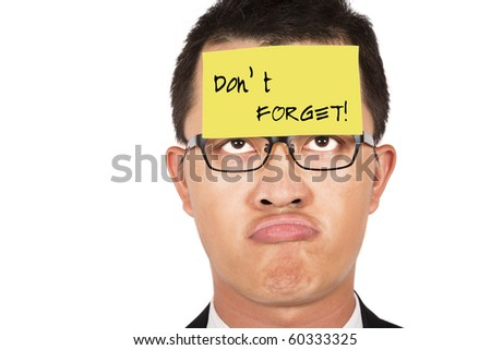 do not forget and keep in mind.young businessman helpless looking the post it - stock photo