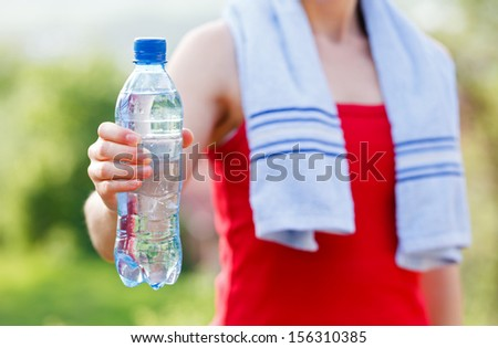 Do not forget to hydrate yourself during workout - stock photo
