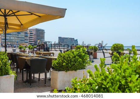 do not need property release, this public space - the street and city beach a summer terrace of traditional European Mediterranean restaurant in Napoli, Italy