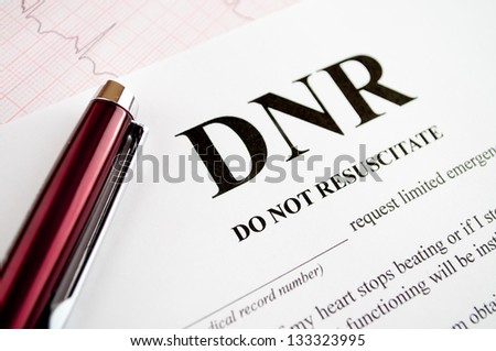 Do Not Resuscitate (DNR) form with pen and EKG tracing - stock photo