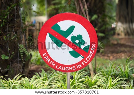 Do not step on flower sign - stock photo