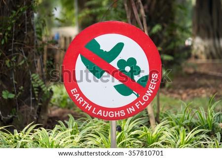 Do not step on flower sign - stock photo