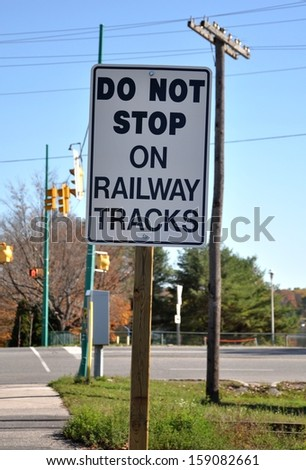 Do not stop on railway tracks sign - stock photo