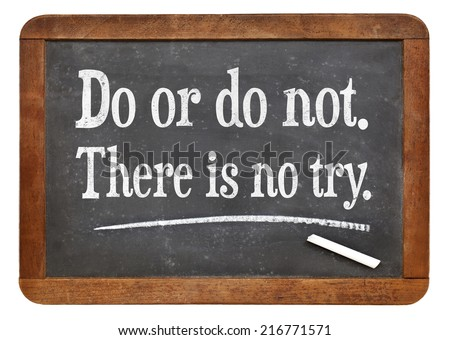 Do or do not. There is no try.  A quote from Yoda character  on a vintage slate blackboard - stock photo