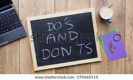 dos donts written on chalkboard office stock photo