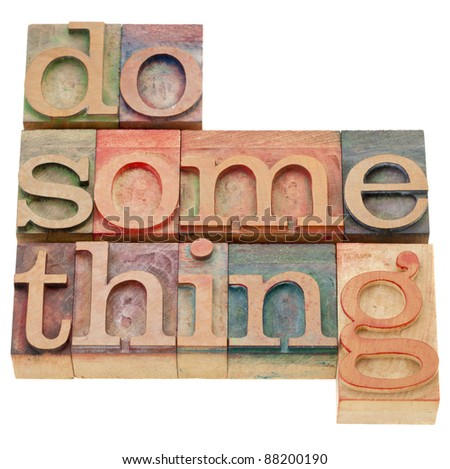 do something - a motivational phrase - isolated words in vintage wood letterpress printing blocks