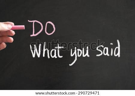 Do what you said words written on blackboard using chalk - stock photo