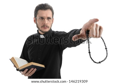 Do you believe in God? Portrait of priest pointing away while standing isolated on white - stock photo