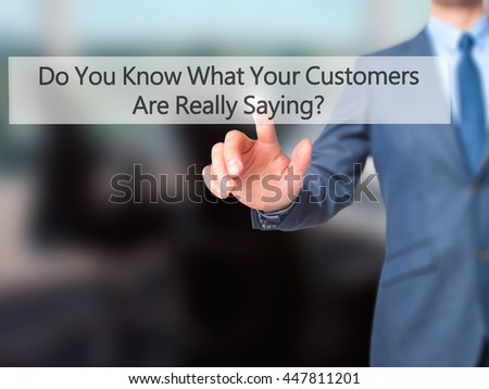 Do You Know What Your Customers Are Really Saying ? - Businessman hand pushing button on touch screen. Business, technology, internet concept. Stock Image - stock photo