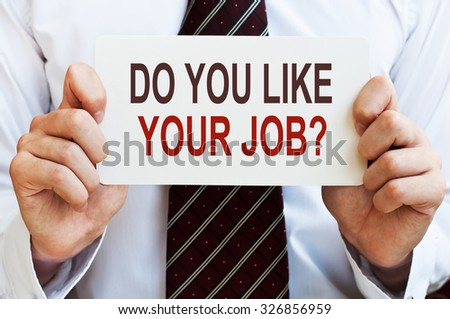 Do You Like Your Job? card in hands - stock photo
