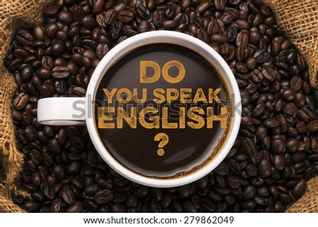 Do you speak english? coffee cup with coffee background - stock photo