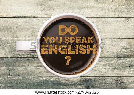 Do you speak english? coffee cup with wood background - stock photo