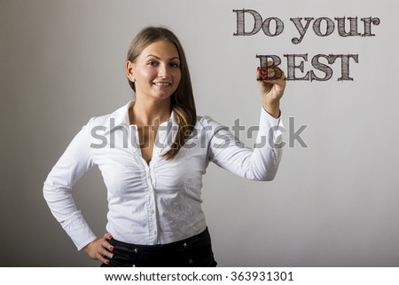 Do your BEST - Beautiful girl writing on transparent surface - horizontal image