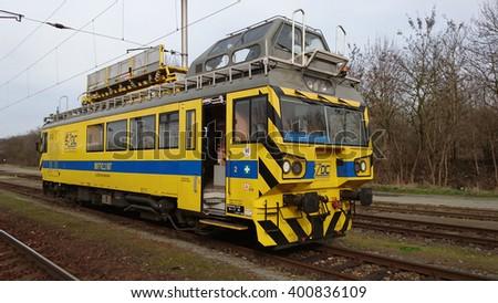 DOBRANY, CZECH REPUBLIC - APRIL 3, 2016: Maintenance Train from Railway Infrastructure Administration (SZDC) at the station. SZDC manage 9478 km of tracks in the Czech Republic. - stock photo