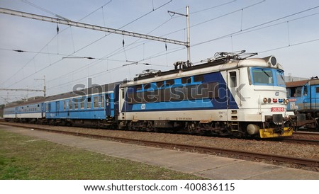 DOBRANY, CZECH REPUBLIC - APRIL 3, 2016: Train Type 242 Ceske drahy from Pilsen arriving to the railway station. Ceske drahy or Czech Railways is the main railway operator in the Czech Republic. - stock photo