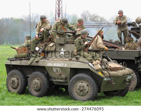 DOBRANY, CZECH REPUBLIC - MAY 1, 2015: American M8 Greyhound with soldiers. Liberation festival to 70th Anniversary of the Liberation by the US Army and the End of the Second World War in Europe.