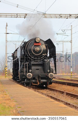DOBRANY, CZECH REPUBLIC - NOVEMBER 28, 2015: Steam locomotive type 475.111 arriving to the railway station. Locomotive was made in Skoda factory year 1947. - stock photo