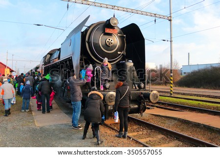 DOBRANY, CZECH REPUBLIC - NOVEMBER 28, 2015: Steam locomotive type 475.111 in the railway station. Locomotive was made in Skoda factory year 1947. - stock photo