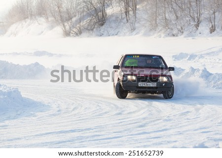 Dobryanka, Russia - February 7, 2015. Urban ice race. Black car vaz-2114 goes into a sharp turn to snow sports track - stock photo