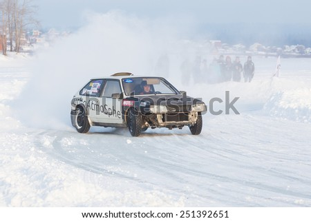 Dobryanka, Russia - February 7, 2015. Urban ice race. Black VAZ-2114 on winter road - stock photo