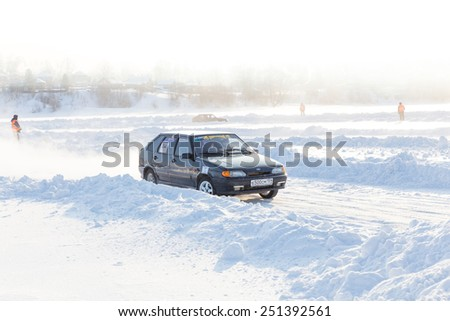 Dobryanka, Russia - February 7, 2015. Urban ice race. Black VAZ-2114 on winter tracks - stock photo