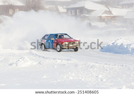 Dobryanka, Russia - February 7, 2015. Urban ice race. Blue red VAZ-2114 racing on snow race track - stock photo