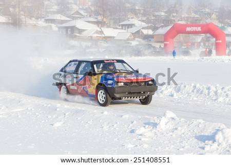 Dobryanka, Russia - February 7, 2015. Urban ice race.  Bright VAZ-2114 racing on snow race track in winter - stock photo