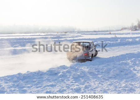 Dobryanka, Russia - February 7, 2015. Urban ice race.  Lada VAZ-2107 racing on snow race track - stock photo