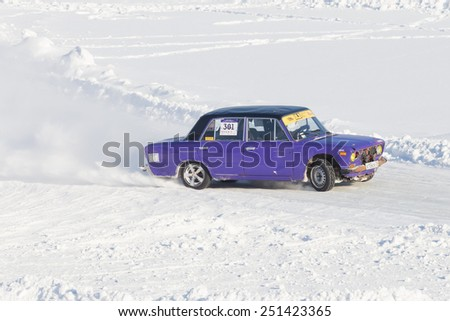 Dobryanka, Russia - February 7, 2015. Urban ice race. purple vaz-2107 on the road snow sports top view - stock photo