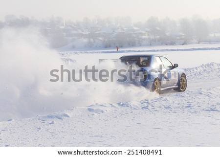 Dobryanka, Russia - February 7, 2015. Urban ice race.  Sport car racing on snow race track in winter - stock photo