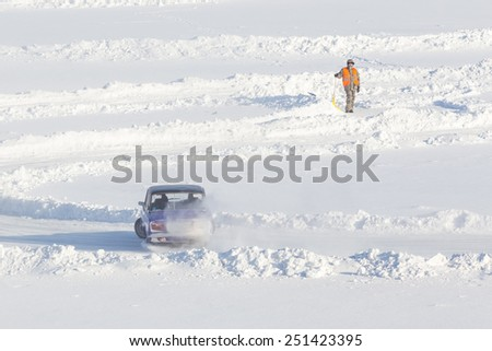 Dobryanka, Russia - February 7, 2015. Urban ice race. VAZ-2107 on the road snow sports top view - stock photo