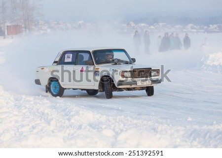 Dobryanka, Russia - February 7, 2015. Urban ice race. White VAZ-2107 on winter road - stock photo